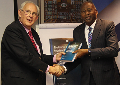 The author, Dr Riaan Eksteen, presenting a copy of his book to the Hon. Dr Peter Katjavivi, Speaker of Namibia's National Assembly, during the presentation of the book in Windhoek, Namibia, on 9 August 2019