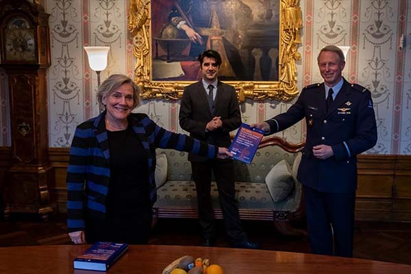 Prof Dr Frans Osinga (seen on the right) presenting a copy of NL ARMS 2020 to Ank Bijleveld, Netherlands Minister of Defence (seen on the left), on behalf of the Netherlands Defence Academy during the presentation of the book on 28 January 2021